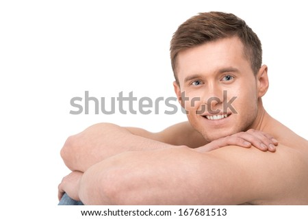 Portrait of muscular fit sexy sportsman. Resting head on muscular bare hands - stock photo