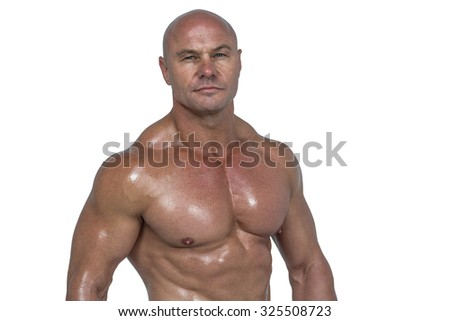Portrait of muscular man against white background - stock photo