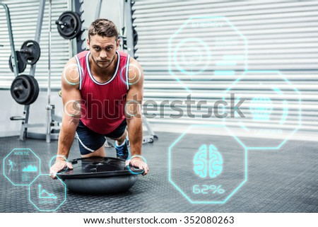 Portrait of muscular man using bosu ball against fitness interface - stock photo