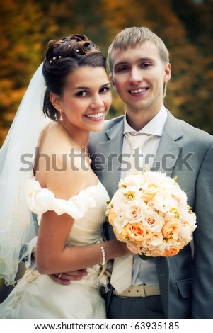 Portrait of newlyweds in autumn park in moscow estate - stock photo