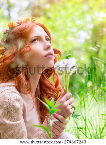 Portrait of nice dreamy woman on fresh green field with dandelion flower bouquet, having fun in spring park, enjoy nature beauty - stock photo