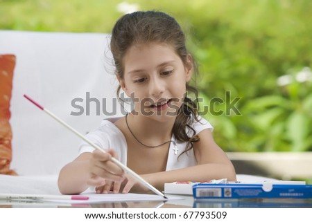 portrait of nice little girl getting busy  in summer environment - stock photo