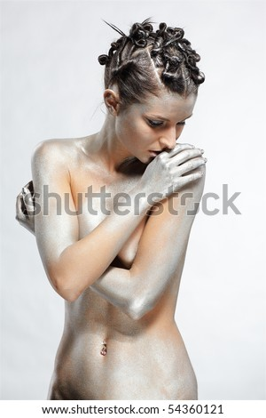 portrait of nude girl body painted with silver posing on gray - stock photo