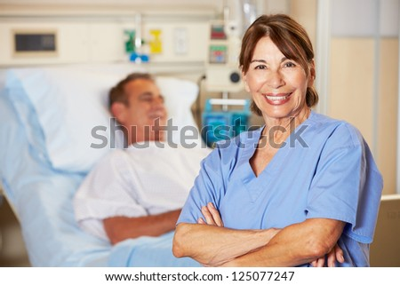 Portrait Of Nurse With Patient In Background - stock photo