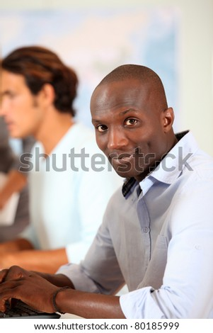 Portrait of office worker at work - stock photo