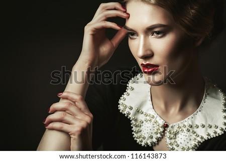portrait of old-fashioned woman with collar - stock photo