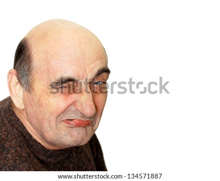 portrait of old man with a grimace on his face - stock photo