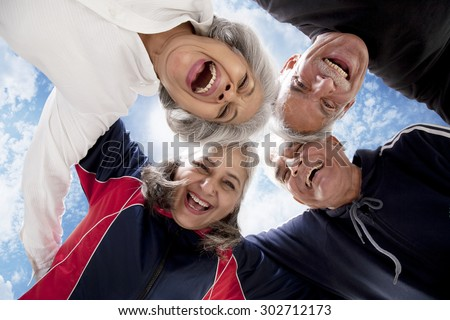 Portrait of old people enjoying - stock photo