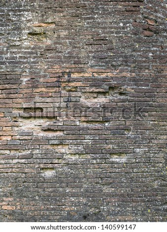 Portrait of old weathered brick wall - stock photo