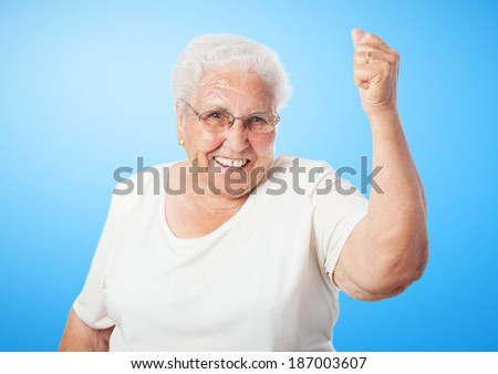 portrait of old woman doing a winner gesture - stock photo
