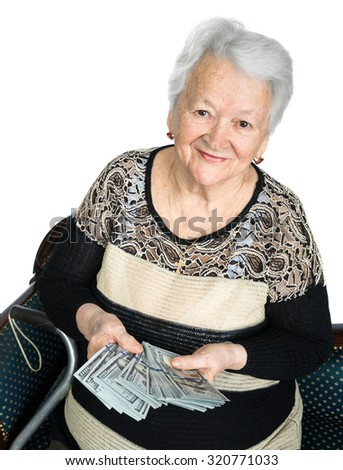Portrait of old woman holding money in hands on a white background - stock photo