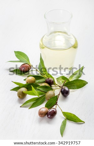 portrait of olive oil with green olives and black olives isolated on white - stock photo