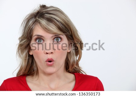 Portrait of open-mouthed woman - stock photo
