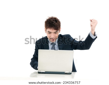 portrait of oung business men with laptop with raised hands up - stock photo
