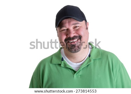 Portrait of Overweight Man Wearing Green Shirt and Black Baseball Cap Smiling in front of White Background, Head and Shoulders Portrait of Joyful Man - stock photo