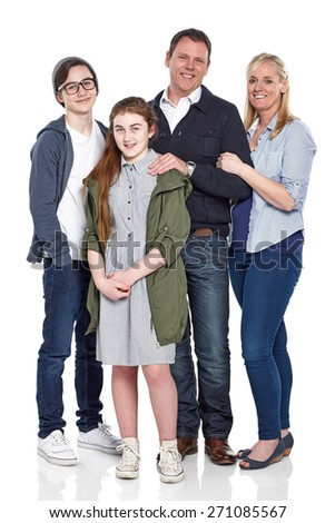 Portrait of parents with their children standing and posing for camera on white background  - stock photo