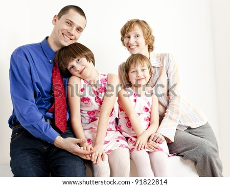 portrait of parents with their daughters - stock photo