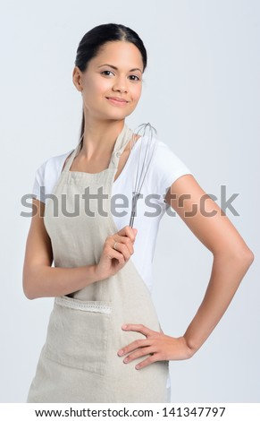 Portrait of pastry chef with kitchen whisk - stock photo