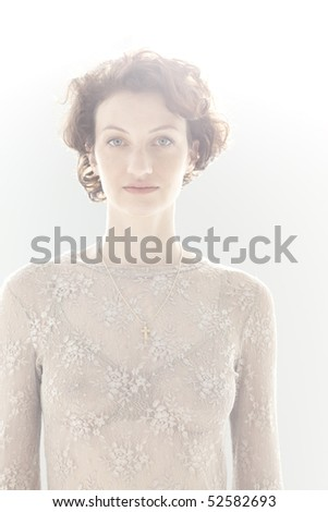 Portrait of peaceful young woman indoors - stock photo