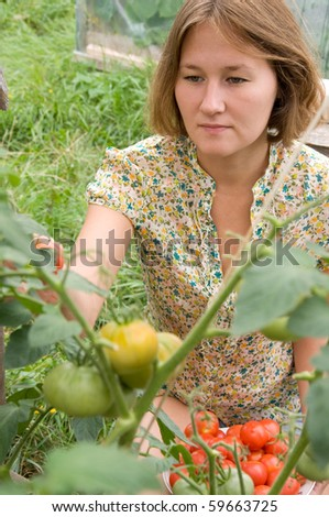 portrait of peasant woman in garden - stock photo