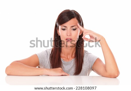 Portrait of pensive adult lady wondering while looking down on isolated white background - copyspace - stock photo