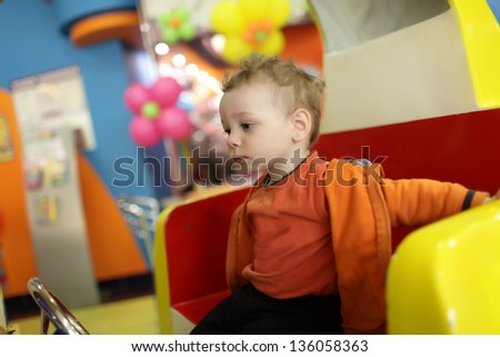 Portrait of pensive child at indoor playground - stock photo