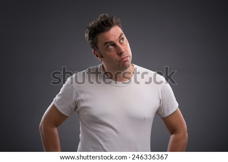 Portrait of pensive man looking up - stock photo
