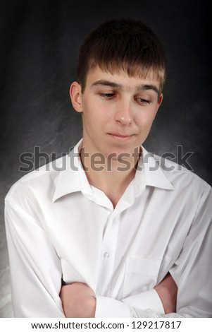 Portrait of Pensive Young Man on the Black Background - stock photo