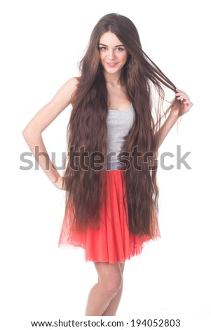 Portrait of perfect woman with long hair on white background - stock photo
