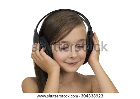 Portrait of posing Caucasian brunette young girl of 6 or 7 years old. Girl is wearing headset and listening to the music with eyes closed. It is studio shot isolated over white.  - stock photo
