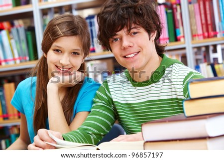 Portrait of positive students looking at camera and smiling - stock photo