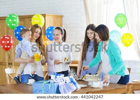 Portrait of pregnant woman with friends at a baby shower - stock photo