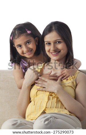 Portrait of pregnant woman with her daughter - stock photo