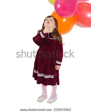Portrait of preschooler girl in velvet dress. Charming child with air baloons posing on white background indoors. Studio shot. Isolate on white - stock photo