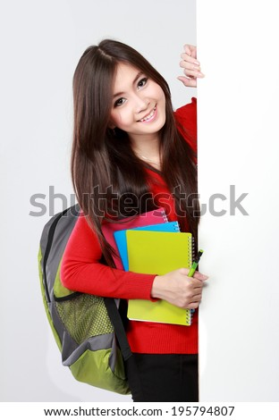 Portrait of Pretty asian female student portrait with blank white board isolated over white background - stock photo