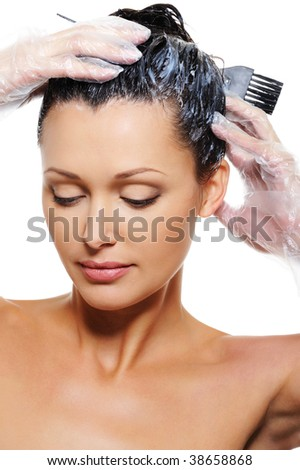 Portrait of pretty beautiful young woman dyeing  hairs - stock photo