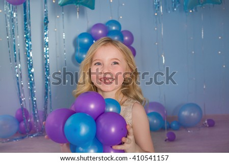 Portrait of Pretty blonde little girl with a balloons in a hands - stock photo