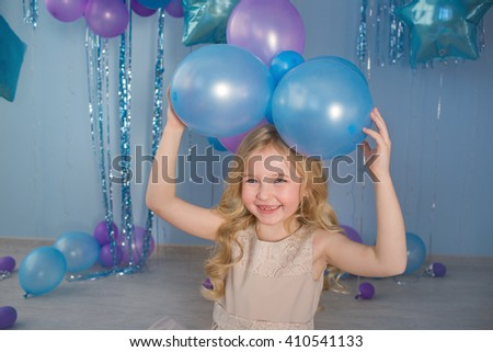 Portrait of Pretty blonde little girl with a color balloons over a head - stock photo