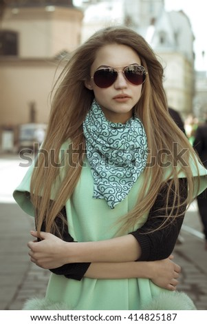 Portrait of pretty blonde woman in a sunglasses. Closeup shot - stock photo