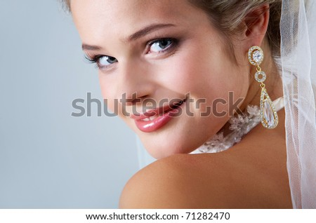 Portrait of pretty bride looking at camera - stock photo