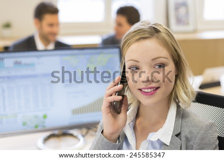 Portrait of pretty businesswoman in modern office. looking camera - stock photo