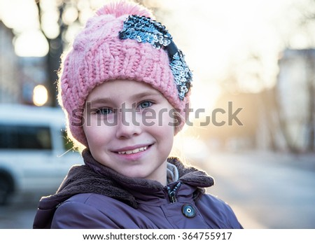 Portrait of pretty Caucasian girl  in winter clothes and hat - stock photo