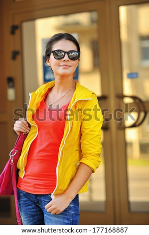 Portrait of pretty cheerful young woman - stock photo