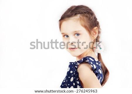Portrait of pretty cute girl wearing the dark blue dress - stock photo