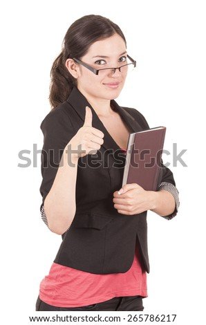 portrait of pretty female teacher wearing glasses and holding book gesturing good job isolated on white - stock photo