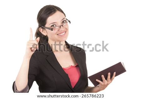 portrait of pretty female teacher wearing glasses and holding book with index finger up isolated on white - stock photo