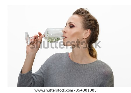 portrait of pretty girl drinking cocktail - stock photo