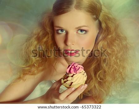 Portrait of pretty girl eating cake, retro style - stock photo
