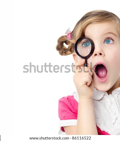 portrait of pretty little girl looking through  magnifying glass making faces mouth open isolated on white studio shot - stock photo
