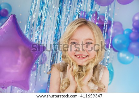 Portrait of Pretty little girl with a big eyes and without a tooth - stock photo